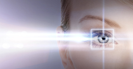 health, vision, sight - woman eye with laser correction frame Reklamní fotografie