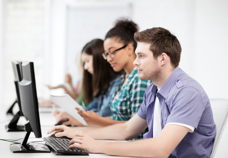 computer class: education concept - student with computers studying at school Stock Photo