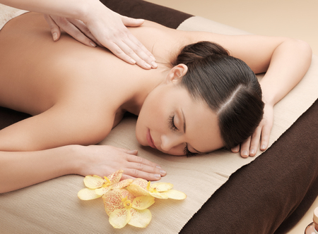 body care: health and beauty, resort and relaxation concept - asian woman in spa salon getting massage