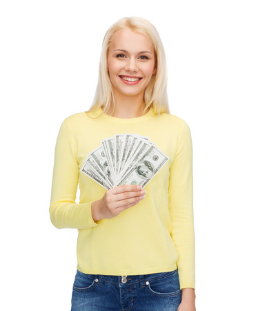 money, finances and people concept - smiling girl with dollar cash money photo