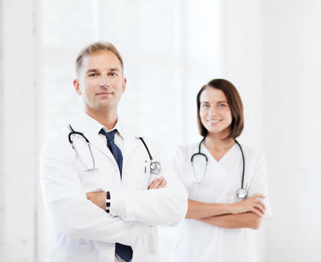 medical instruments: healthcare and medical concept - two doctors with stethoscopes