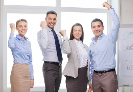 business, office, success and victory concept - happy business team celebrating victory in office Stock Photo