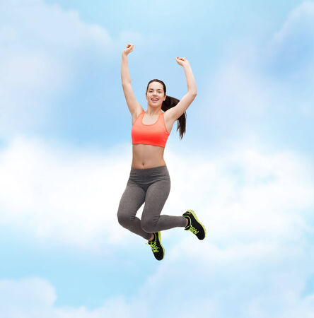 slender woman: fitness and diet concept - beautiful sporty teenage girl jumping in sportswear