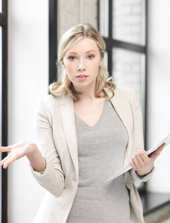 business concept - indoor picture of worried woman with documents photo
