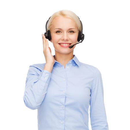 ビジネス、技術およびコール センター コンセプト - ヘッドフォンでフレンドリーな女性ヘルプライン演算子