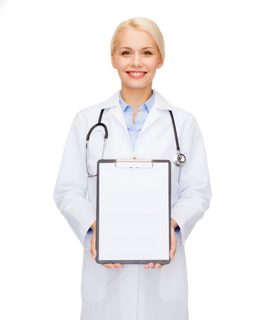 healthcare and medicine concept - smiling female doctor with stethoscope and clipboard and blank page photo