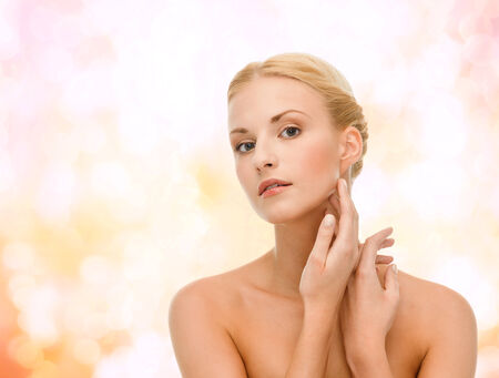 sensitive skin: beauty and spa concept - face of beautiful woman touching her face skin Stock Photo