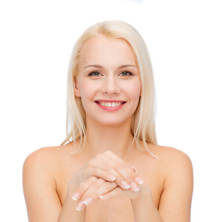 handcare: health and beauty concept - face and hands of beautiful woman Stock Photo