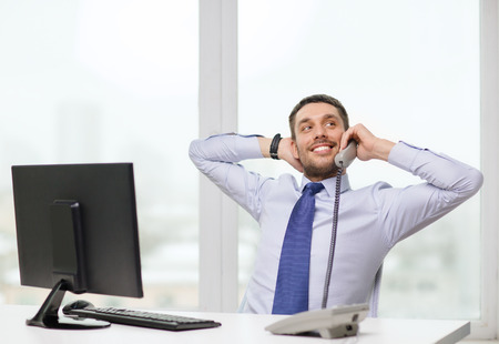 office, business, education, technology and internet concept - smiling businessman or student with computer and phone photo