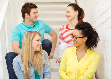 friendship and education concept - smiling teenagers hanging out photo