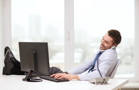 work break: office, business, education, technology and internet concept - smiling businessman or student with computer and phone