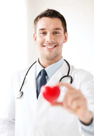 cardiologist: healthcare and medical concept - male doctor with  heart