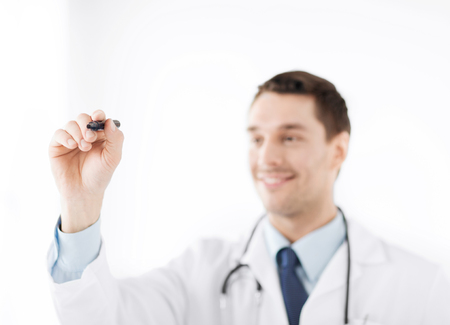 doctor writing: medicine, health and hospital concept - doctor writing something in the air with marker
