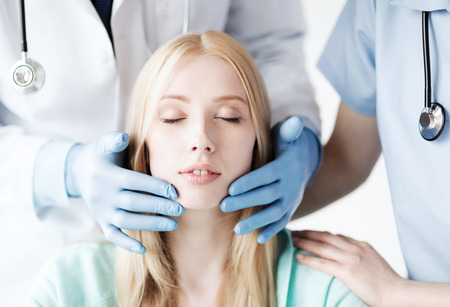 cosmetic surgery: healthcare, medical and plastic surgery concept - plastic surgeon or doctor with patient Stock Photo