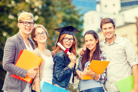 mba: education, campus and teenage concept - group of students or teenagers with files, folders, eyeglasses and diploma Stock Photo