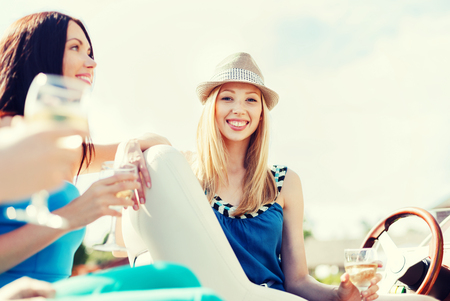 summer holidays and vacation - girl with champagne glass on boat or yacht photo