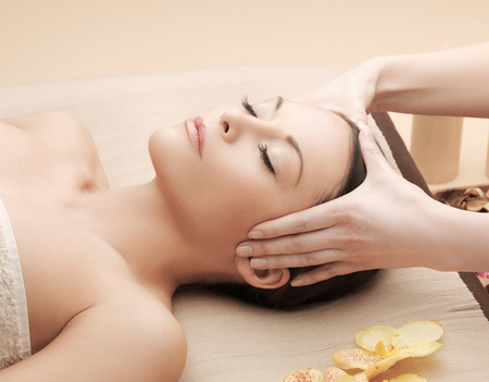 massages: health and beauty, resort and relaxation concept - asian woman in spa salon getting massage