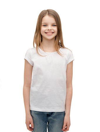 preteen girls: advertising and t-shirt design concept - smiling little girl in white blank t-shirt over white background