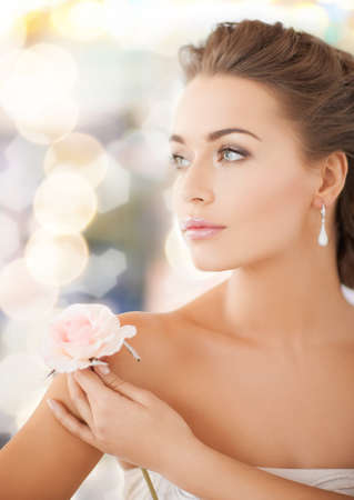 sexy bride: bride and wedding concept - young woman with rose flower Stock Photo
