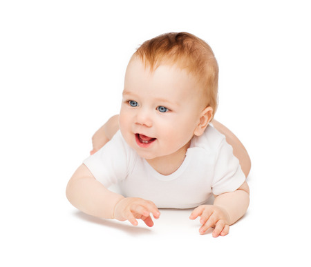child and toddler concept - smiling baby lying on floor