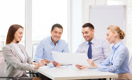 business and office concept - smiling business team having discussion in office photo