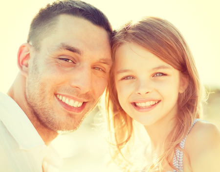 summer holidays, children and people concept - happy father and child girl having fun photo