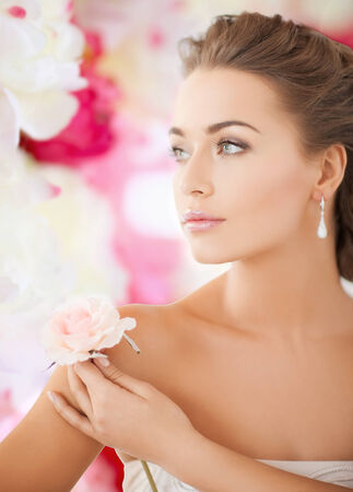 bride and wedding concept - young woman with rose\ flower