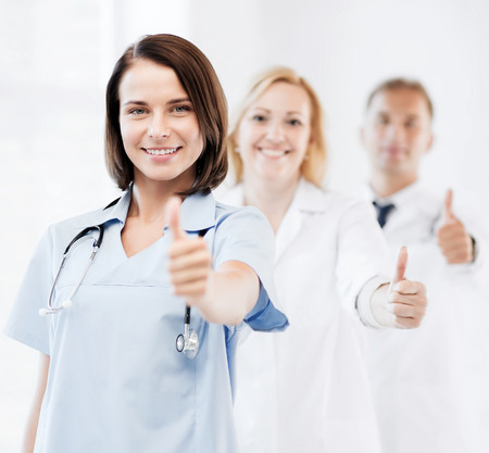healthcare and medical concept - team of doctors showing thumbs up Stock Photo - 28897631