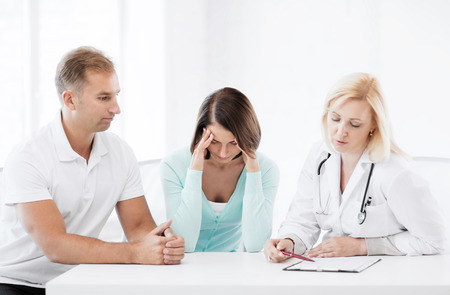 healthcare and medical concept - doctor with patients in cabinet photo