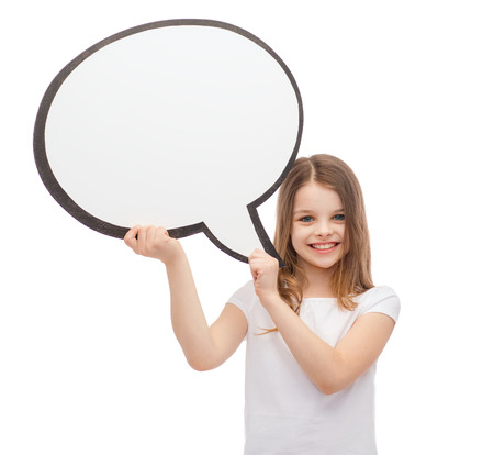happiness, child, conversation and people concept - smiling little girl with blank text bubble photo