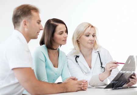 patients: healthcare and medical concept - doctor with patients looking at x-ray