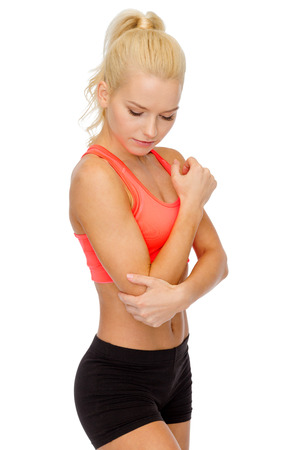 healthcare, fitness and medicine - sporty woman with pain in elbow photo