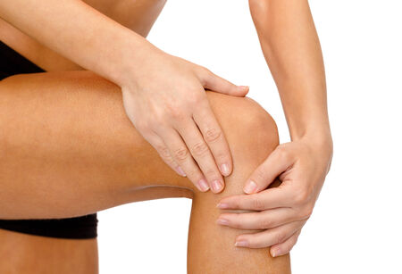 fitness, healthcare and medicine concept - close up of female hands holding knee photo