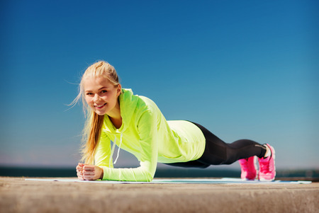 active lifestyle: sport and lifestyle concept - woman doing sports outdoors Stock Photo