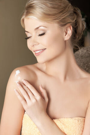 picture of attractive woman applying skin creme photo