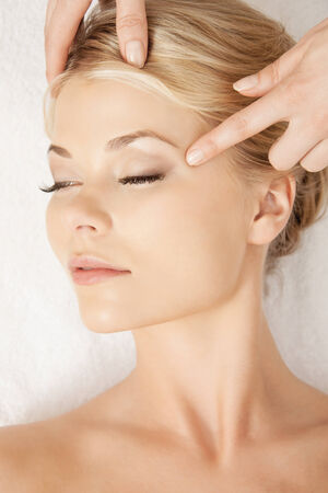 pampered: picture of calm beautiful woman in massage salon Stock Photo