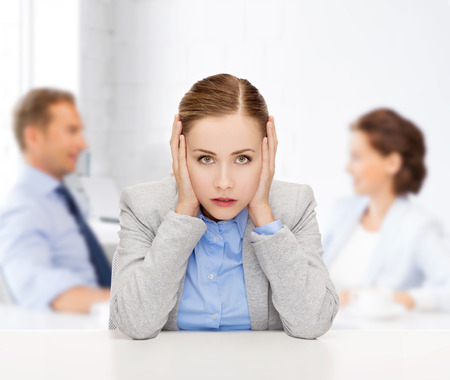 noise: business and office concept - stressed businesswoman covering her ears with hands Stock Photo
