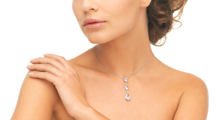 wedding, bridal jewelry and luxury concept - beautiful woman wearing shiny diamond necklace