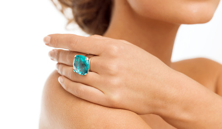 wedding, bridal jewelry and luxury concept - picture of beautiful woman with big blue cocktail ring photo