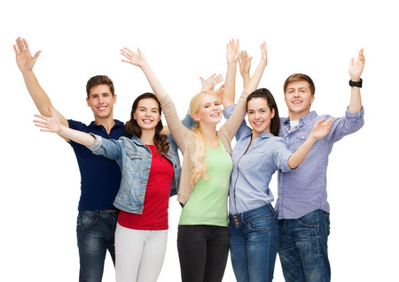 education and people concept - group of smiling students standing and waving hands photo