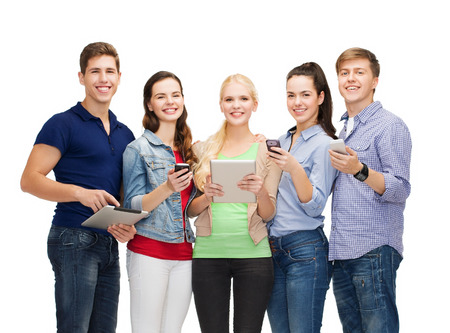 education and modern technology concept - smiling students using smartphones and tablet pc photo