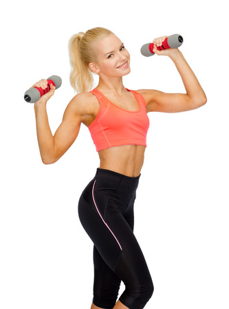 fitness, sport and diet concept - smiling beautiful sporty woman with dumbbells photo
