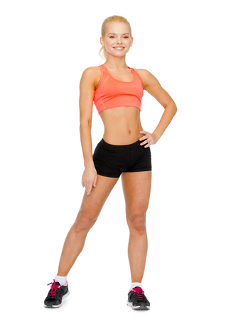 athletic wear: fitness, sport and diet concept - beautiful athletic woman in sportswear