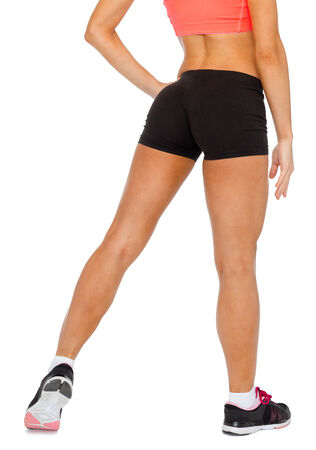 body curve: fitness, exercising and dieting concept - close up of female legs in sportswear