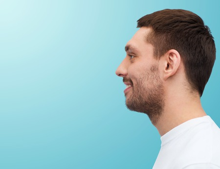 Male Profile: health and beauty concept - portrait of smiling young handsome man
