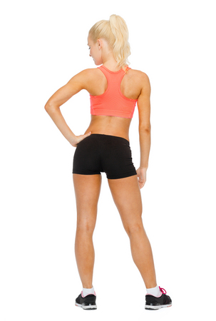 athletic wear: fitness, sport and diet concept - beautiful athletic woman in sportswear from the back
