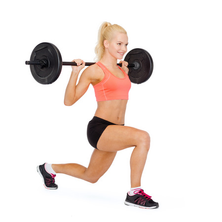 pump: fitness, sport and exercise concept - smiling sporty woman with barbell doing split squat or lunge
