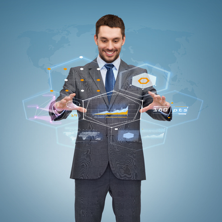 business, technology, communication concept - smiling businessman working with virtual screen photo