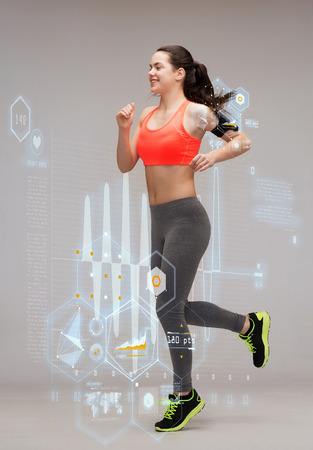 fitness, sport and dieting concept - beautiful sporty woman running or jumping photo