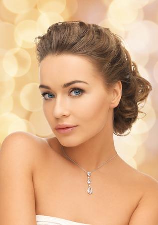 woman neck: beauty and jewelry concept - woman wearing shiny diamond pendant Stock Photo